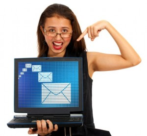 Smiling Girl Pointing To Notebook Computer Screen - For Adding Own Message